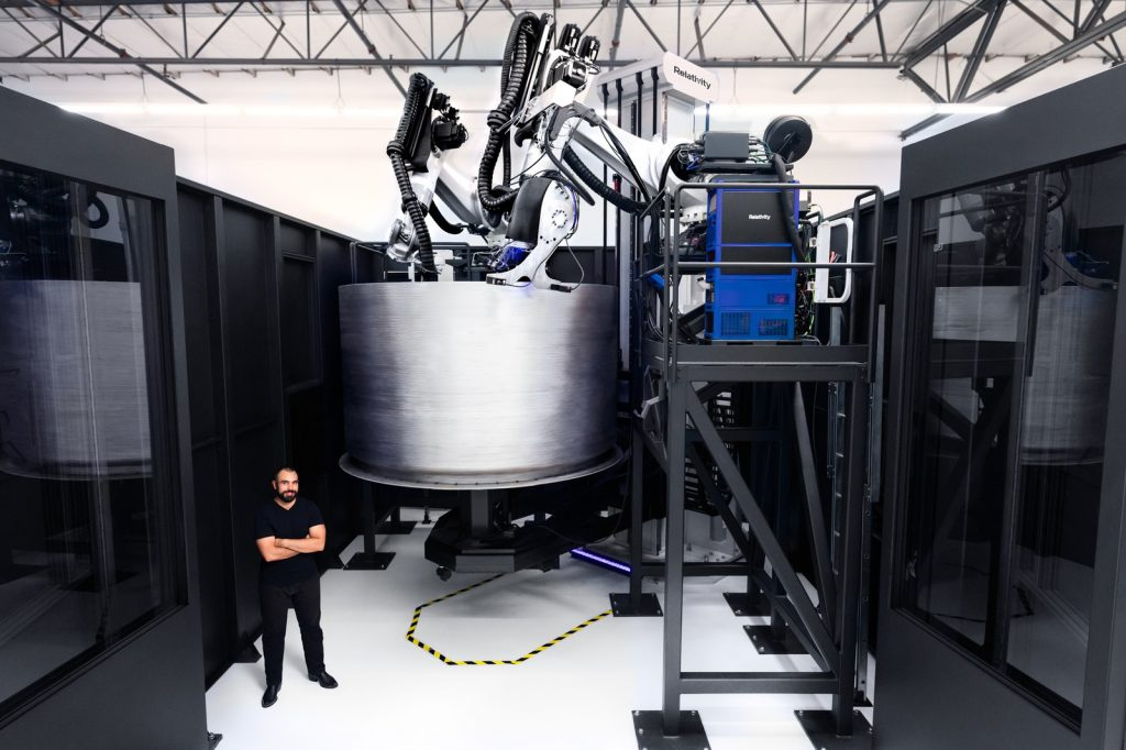 Jordan Noone, Relativity's CTO and cofounder, stands beside the second version of the Stargate 3D printer at the company's headquarters. Source: Relativity