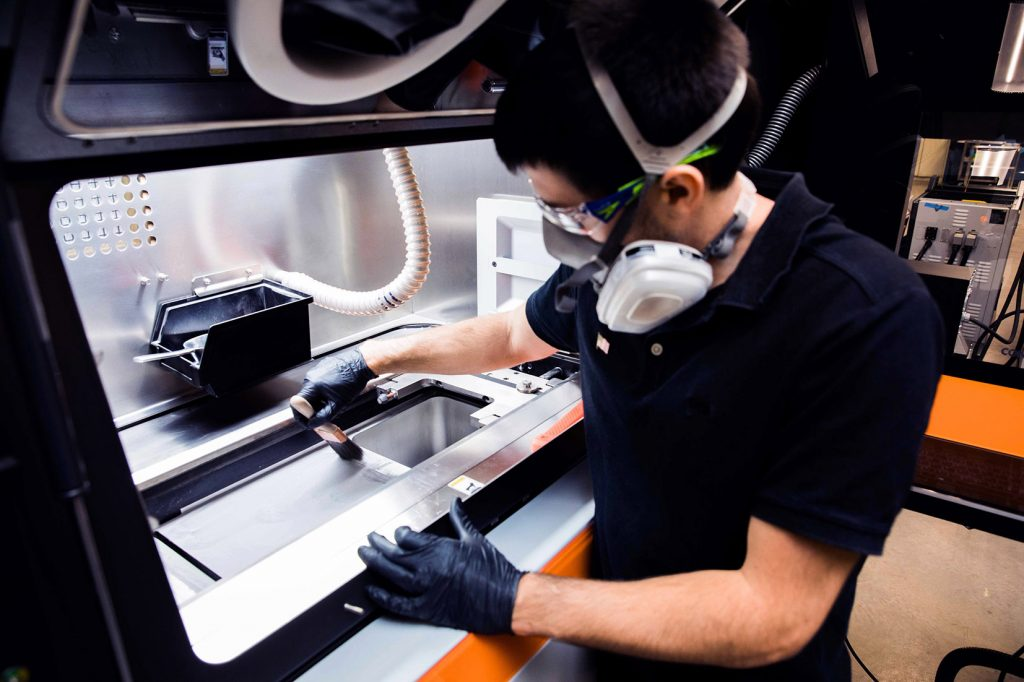 A metal powder bed being prepared for printing parts (Photo: Protolabs)