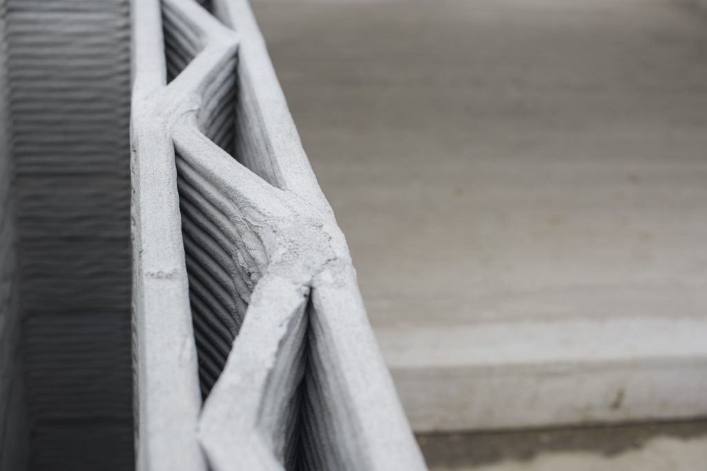 Topology Optimized Digital Fabrication in Construction Industry